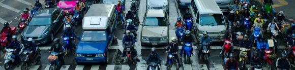 Motor cycle -front areial shot lane splitting - Oblong